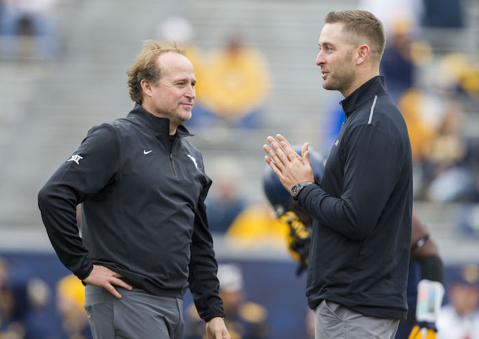 Nov 7, 2015; Morgantown, WV, USA; West Virginia Mountaineers head coach Dana Holgorsen (left) talks with Texas Tech Red Raiders head coach Kliff Kingsbury (right) before their game at Milan Puskar Stadium. Mandatory Credit: Ben Queen-USA TODAY Sports