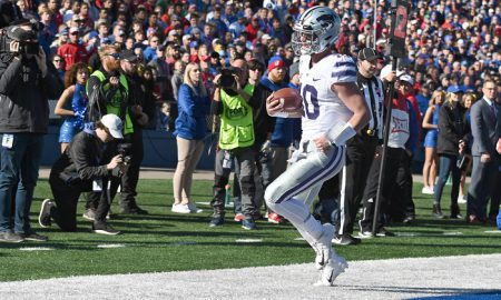 Nov 2, 2019; Lawrence, KS, USA; Kansas State Wildcats quarterback Skylar Thompson (10) runs in for a touchdown against the Kansas Jayhawks during the first half at David Booth Kansas Memorial Stadium. Mandatory Credit: Denny Medley-USA TODAY Sports