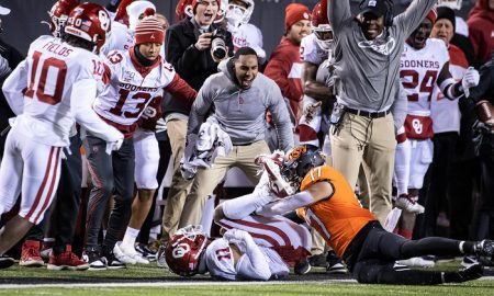 Nov 30, 2019; Stillwater, OK, USA; The Oklahoma Sooners bench celebrates after an interception by cornerback Parnell Motley (11) of a pass intended for Oklahoma State Cowboys wide receiver Dillon Stoner (17) during the second half at Boone Pickens Stadium. Mandatory Credit: Rob Ferguson-USA TODAY Sports